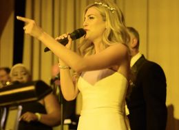 Bride Serenades Husband With Soulful Rendition Of 'Natural Woman'
