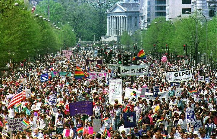Hundreds of thousands of gay-rights demonstrators march down Pennsylvania Avenue in downtown Washington D.C. 25 April 1993.