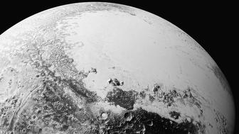A synthetic perspective view of Pluto, based on the latest high-resolution images to be downlinked from NASA's New Horizons spacecraft, shows what you would see if you were approximately 1,100 miles (1,800 kilometers) above Pluto's equatorial area, looking toward the bright, smooth, expanse of icy plains informally called Sputnik Planum, in this image taken July 14, 2015 and released September 10, 2015.  The images were taken as New Horizons flew past Pluto from a distance of 50,000 miles (80,000 kilometers).  REUTERS/NASA/Handout via Reuters