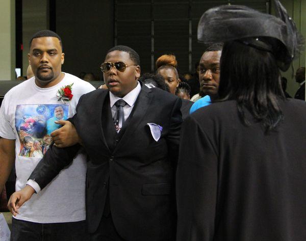 Cameron Sterling, the son of Alton Sterling, enters the funeral of his father.