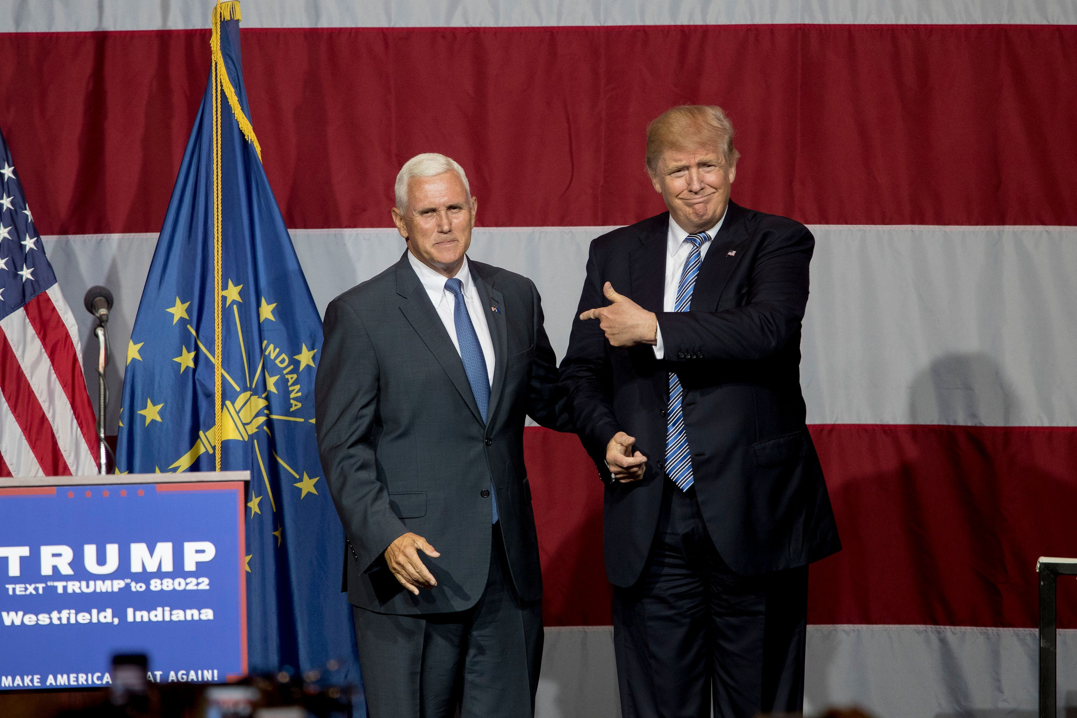 WESTFIELD, IN - JULY 12:   Republican presidential candidate Donald Trump greets Indiana Gov. Mike Pence at the Grand Park Events Center on July 12, 2016 in Westfield, Indiana. Trump is campaigning amid speculation he may select Indiana Gov. Mike Pence as his running mate. (Photo by Aaron P. Bernstein/Getty Images)