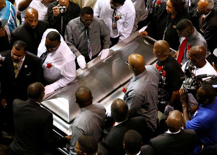 Pallbearers carry the casket of Alton Sterling.