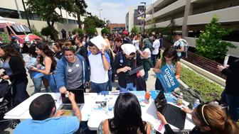 Students line up for voter registration forms, or a chance to meet with celebrities visiting East Los Angeles College for the 'Rock the Campus for Bernie' event in Monterey Park, California on May 10, 2016. Clinton still has active competition for the Democratic nomination despite her virtually insurmountable lead in the delegate count, and rival Bernie Sanders was looking for a big win in West Virginia. / AFP / FREDERIC J. BROWN        (Photo credit should read FREDERIC J. BROWN/AFP/Getty Images)