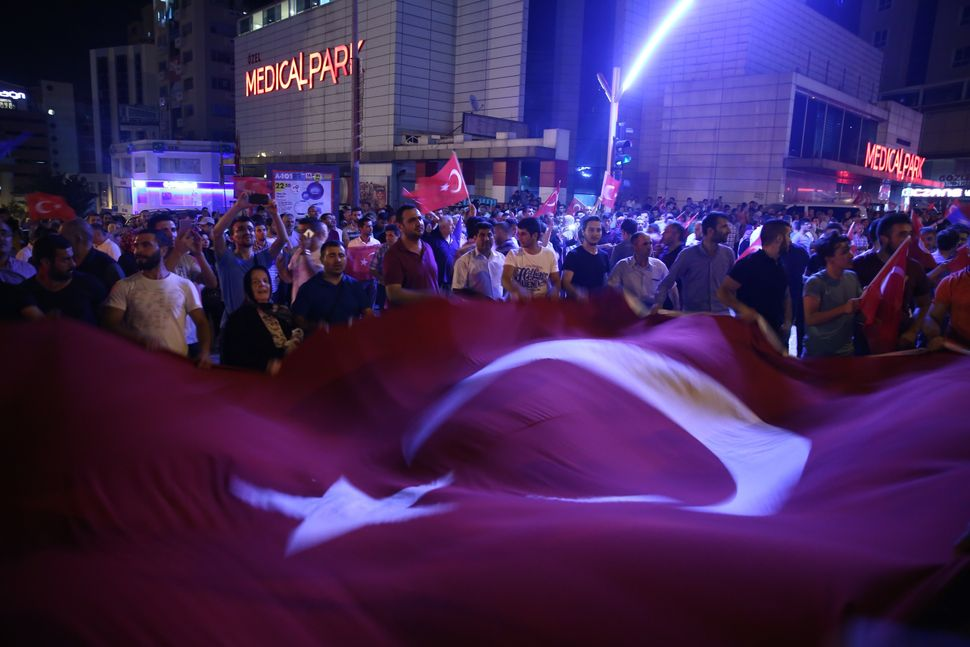 People hold the Turkish flag in Bursa, Turkey.