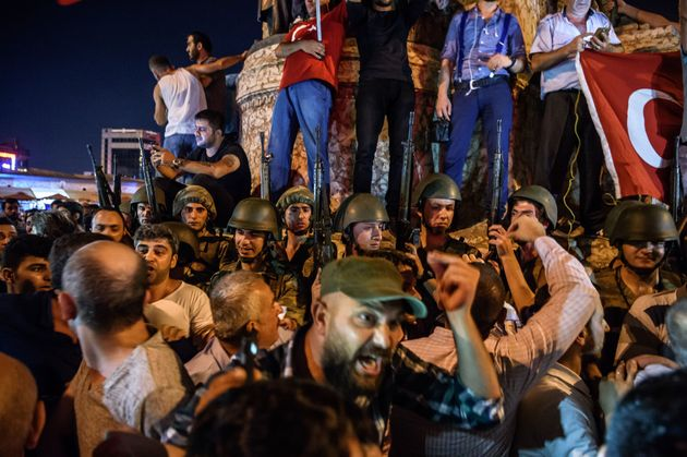 Turkish crowds surround military forces in Istanbul's Taksim square on Saturday