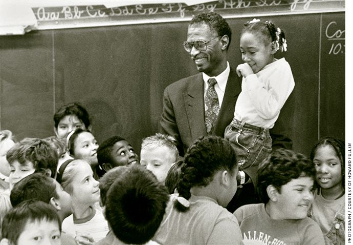 Howard Fuller with a group of schoolchildren in Milwaukee in the early 1990s
