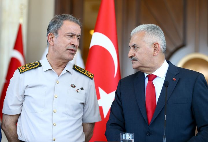 Turkish Prime Minister Binali Yildirim (R) speaks to media at Cankaya Palace with Chief of the General Staff of the Turkish A