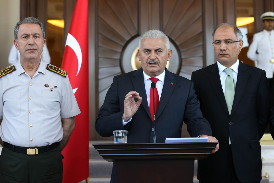 Turkish Prime Minister Binali Yildirim gives a press conference outside the Cankaya Palace in Ankara.