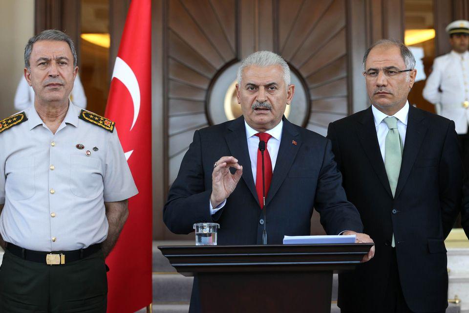 Turkish Prime Minister Binali Yildirim gives a press conference outside the Cankaya Palace in Ankara.