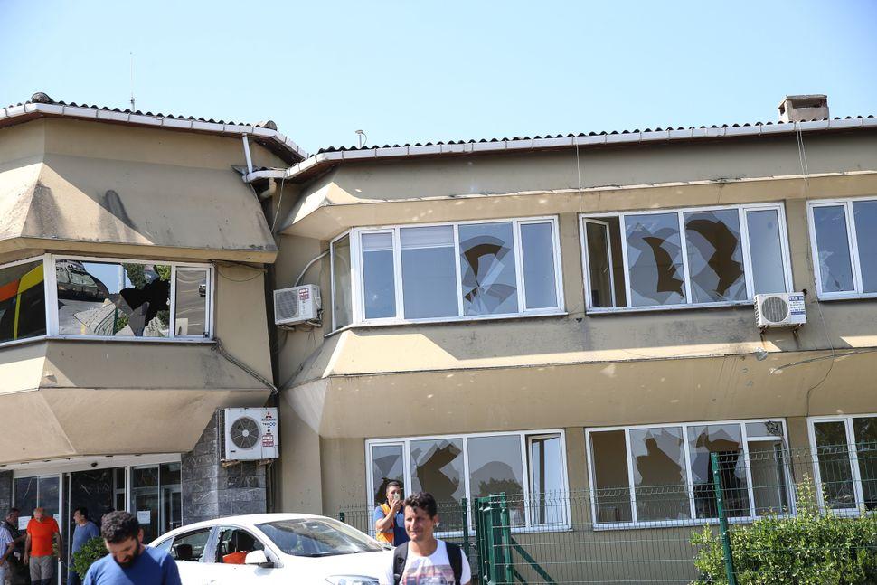 A damaged building is seen near Bosphorus Bridge.