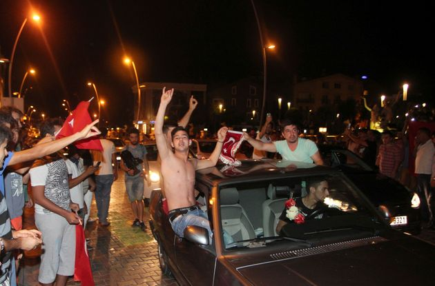 Supporters of Turkish President Tayyip Erdogan in the resort town of Marmaris celebrate after troops...