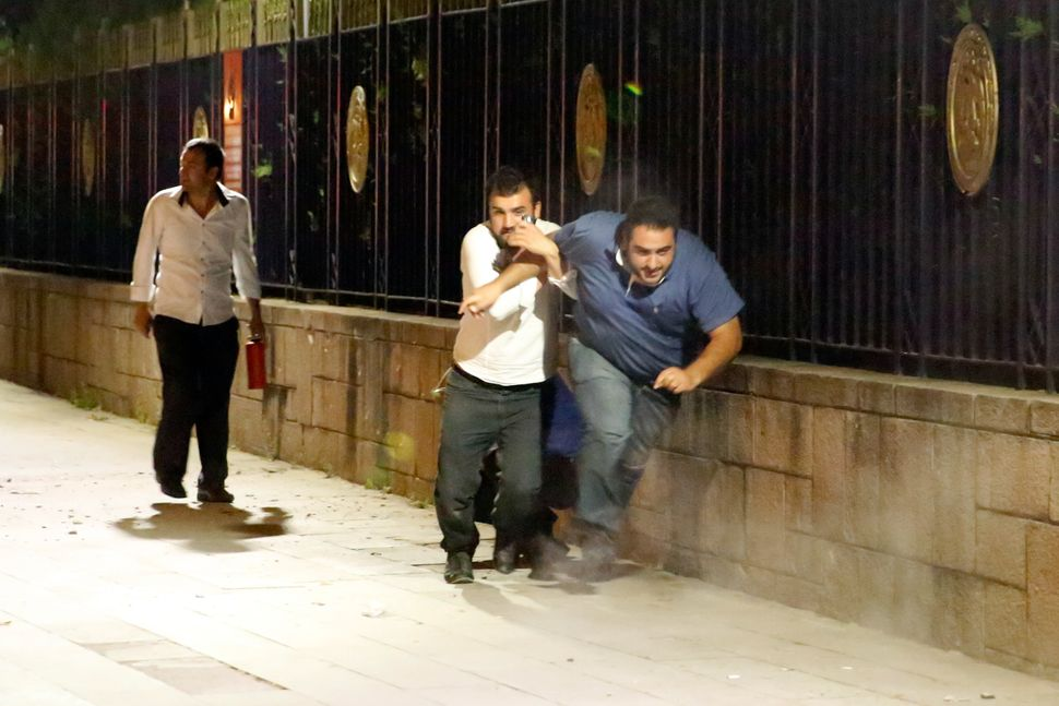 People run to escape from the clashes in Ankara.