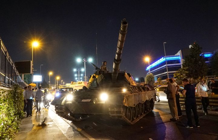People gather near the Turkish army's tank near Ataturk Airport on July 16, 2016 in Istanbul, Turkey.