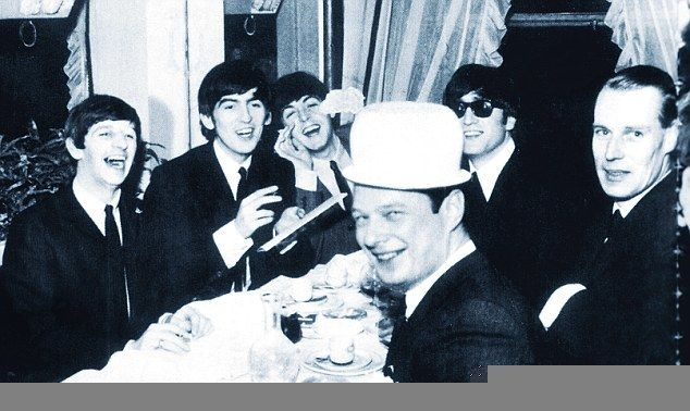 The Beatles with Brian Epstein (L, donning a chamber pot) and George Martin (R) in Paris in January 1964 on the night they le