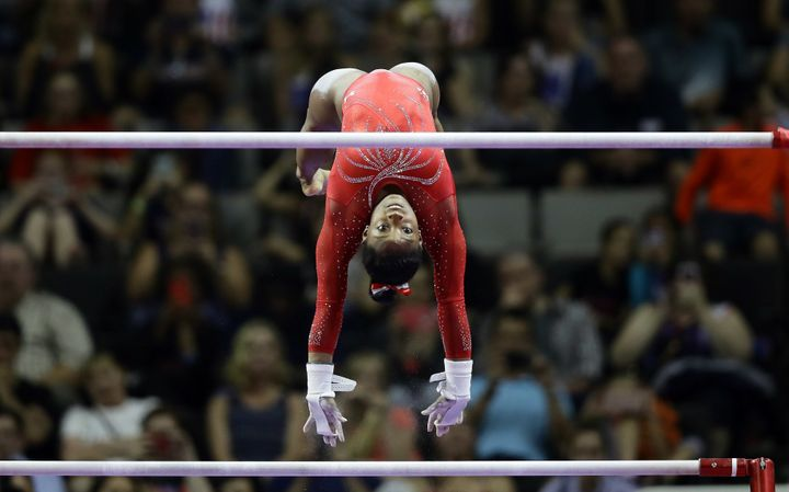 Simone Biles flies from the low bar to the high bar while competing in the U.S. Olympic Trials this June.
