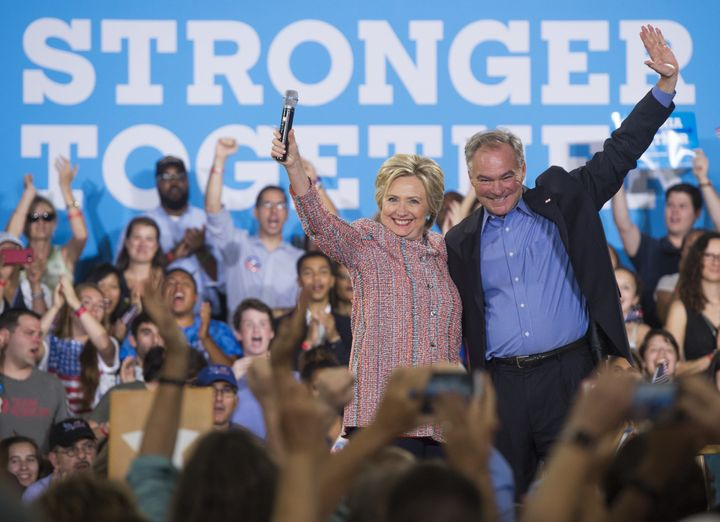 Tim Kaine (right), appearing here at a Clinton campaign event, is widely considered the leading candidate for the D