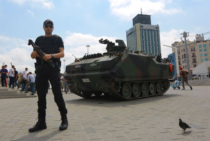 An abandoned tank is guarded at Taksim Square in Istanbul, Turkey, July 17, 2016.