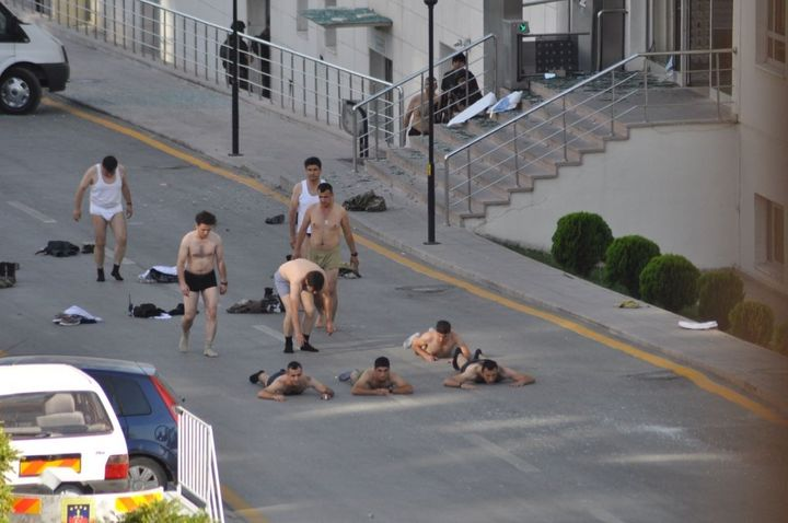 Turkish soldiers, accused of having links to Friday's failed coup, strip down to their underpants while being taken into