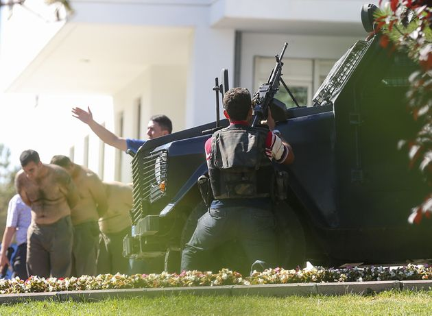 Turkish forces taken soldiers into custody at the Gendarmerie General Command's building in...