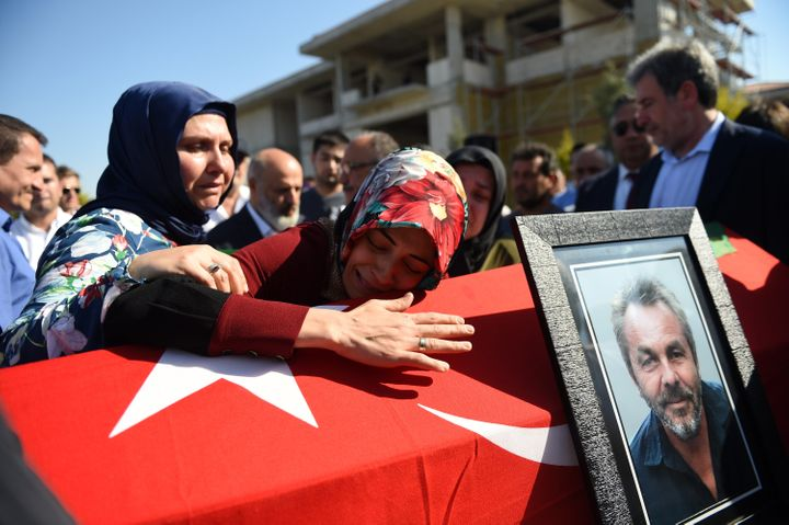 A woman mourns over a coffin on July 17 in Istanbul during the funeral for seven victims of Friday's coup attempt. Turki