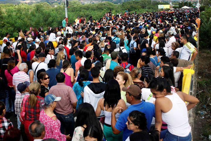 People cross over the Simon Bolivar international bridge to Colombia to take advantage of the temporary border opening.