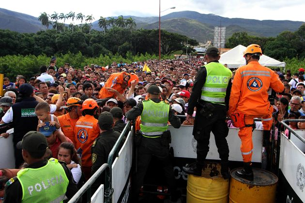 Venezuelans cross the Simon Bolivar bridge linking San Antonio del Tachira, in Venezuela with Cucuta...
