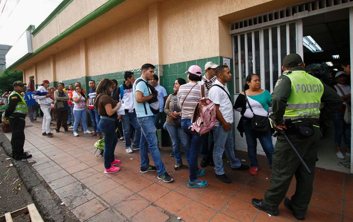 Venezuelans line up to buy at a supermarket in Cucuta, Colombia.