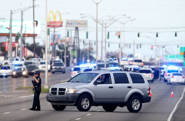 East Baton Rouge Police officers patrol Airline Hwy after 3 police officers were killed early this morning.