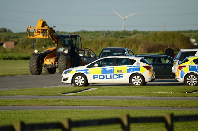 Police at the scene at Breighton airport near Selby, north Yorkshire, where five people have been seriously...