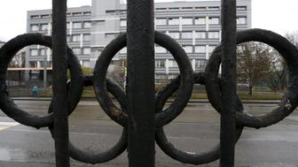 "A view through a fence, decorated with the Olympic rings, shows a building of the federal state budgetary institution ""Federal scientific centre of physical culture and sports"", which houses a laboratory accredited by the World Anti-Doping Agency (WADA), in Moscow, Russia, November 11, 2015. The international investigation into alleged drug cheating inside Russian athletics could draw in other Russian sports since they used the same laboratory that now stands accused of covering up failed drugs tests. REUTERS/Sergei Karpukhin"