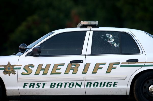 Bullet holes are seen in an East Baton Rouge police car.