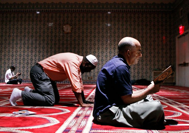 A man reads the Koran in a prayer hall at the Islamic Cultural Center of New York in the Manhattan borough of New York August