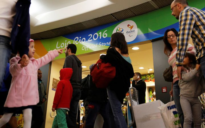 Passengers line up during a security check ahead of the 2016 Rio Olympics at Congonhas Airport in Sao Paulo, Brazil, July 18,
