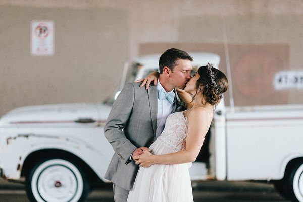 """""""Meagan and Adam were married at Jackson Terminal in Knoxville, Tennessee on July 16. Adam surprised Meagan by restoring her"""