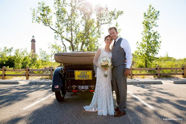 """""""Ben and Emily and their 101-year-old getaway car in front of Little Sable Point Lighthouse in Shelby, Michigan!"""" --<i>"""