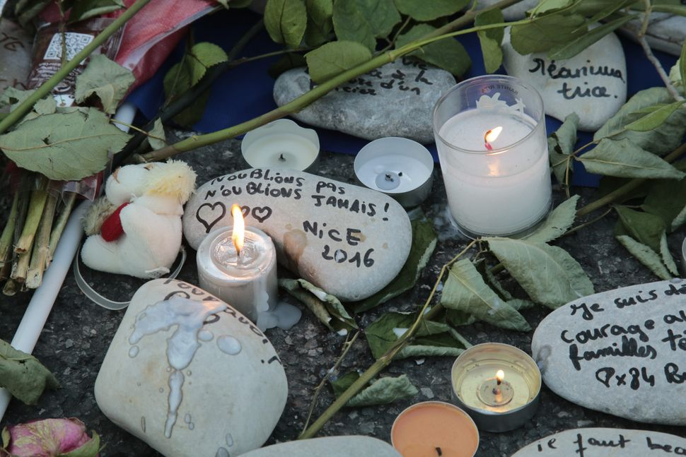 Stones with messages written on them were placed at the memorial.