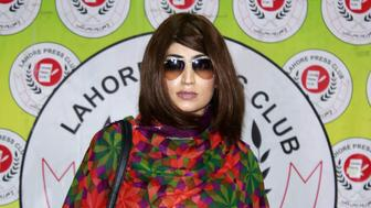 In this photograph taken on June 28, 2016, Pakistani social media celebrity, Qandeel Baloch arrives for a press conference in Lahore.  A Pakistani social media celebrity whose online antics polarised the deeply conservative Muslim country has been murdered by her brother in a suspected honour killing, officials said on July 16, prompting a wave of shock and revulsion. Qandeel Baloch, held up by many of the country's youth for her willingness to break social taboos but condemned and reviled by traditional elements, was strangled near the city of Multan, police said. / AFP / STR        (Photo credit should read STR/AFP/Getty Images)