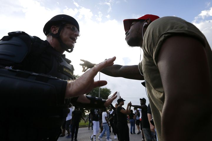 A man protesting the shooting death of Alton Sterling argues with law enforcement near the headquarters of the Baton Rouge Po