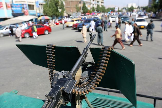 Security forces stand guard during the first day of Eid-al-Fitr outside a mosque in Kabul, Afghanistan....