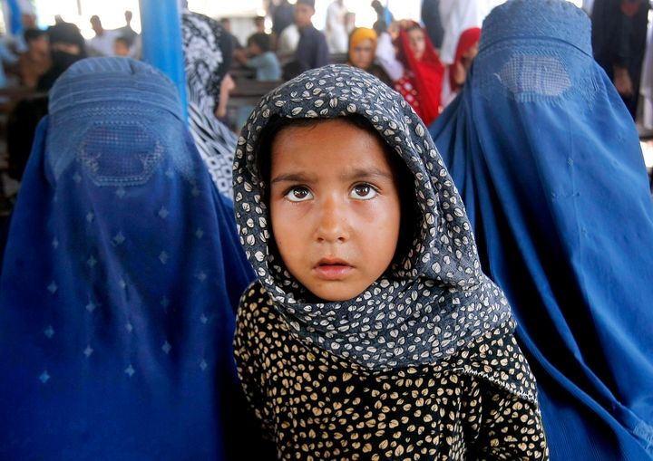 Afghan refugees wait for their documents in order to go back to Afghanistan at the UNHCR's Repatriation Center in Peshawar, P
