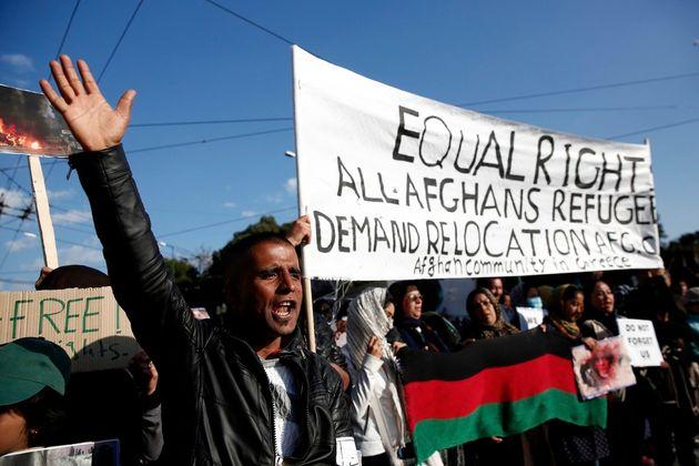 Afghan migrants chant slogans against the E.U.-Turkey