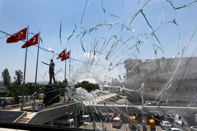 A damaged window is pictured at the police headquarters in Ankara, Turkey, on July