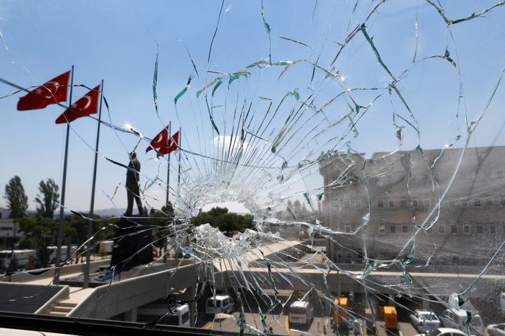 A damaged window is pictured at the police headquarters in Ankara, Turkey, on July 18.