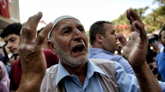 An old man reacts during the funeral of the fellow police officer Erol Ince in Istanbul, on July 18, 2016.  Turkey launched fresh raids and sacked almost 9,000 officials today in a relentless crackdown against suspects behind an attempted coup that left over 300 people dead, as Western allies warned against reinstating the death penalty. / AFP / ARIS MESSINIS        (Photo credit should read ARIS MESSINIS/AFP/Getty Images)