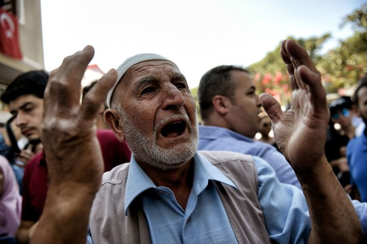 A Turkishman reacts during the July 18 funeral of police officer Erol Ince, killed in Friday's thwarted coup attempt, i