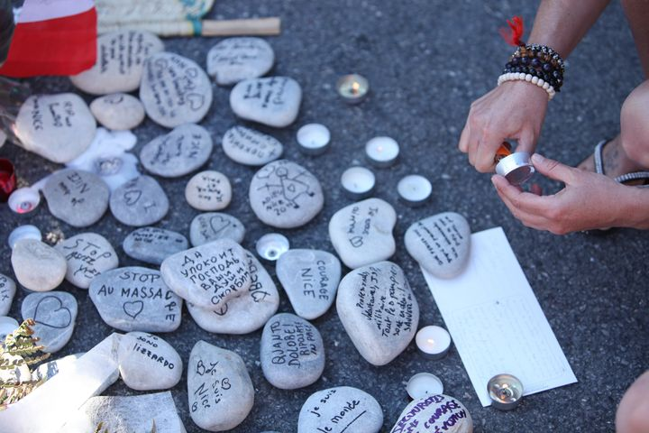 People gather and lay tributes on the Promenade des Anglais on July 17 in Nice, France.