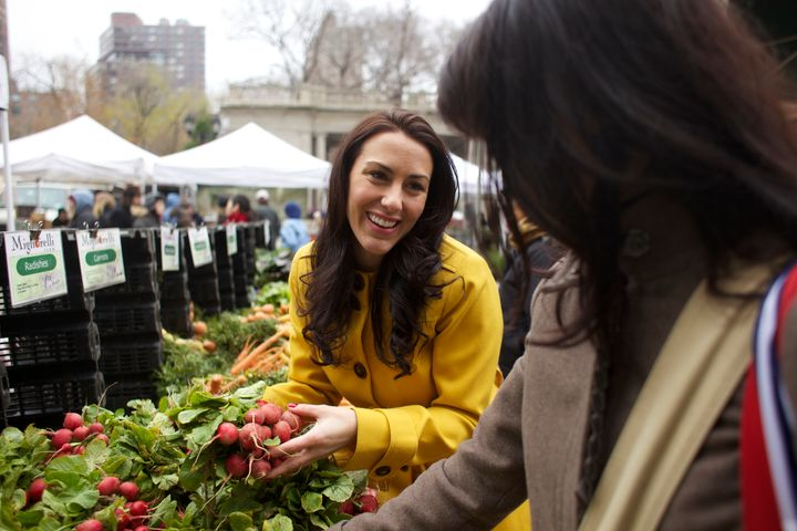 Tara Magalski, showing her client how to shop the Union Square Farmer's Market.