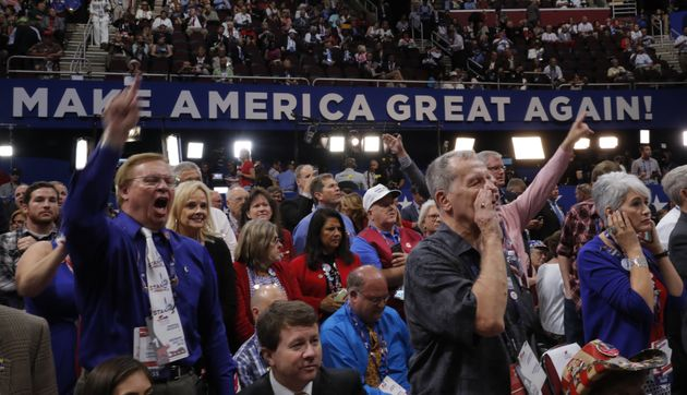 Republican National Convention delegates yell and scream as the Republican National Committee Rules