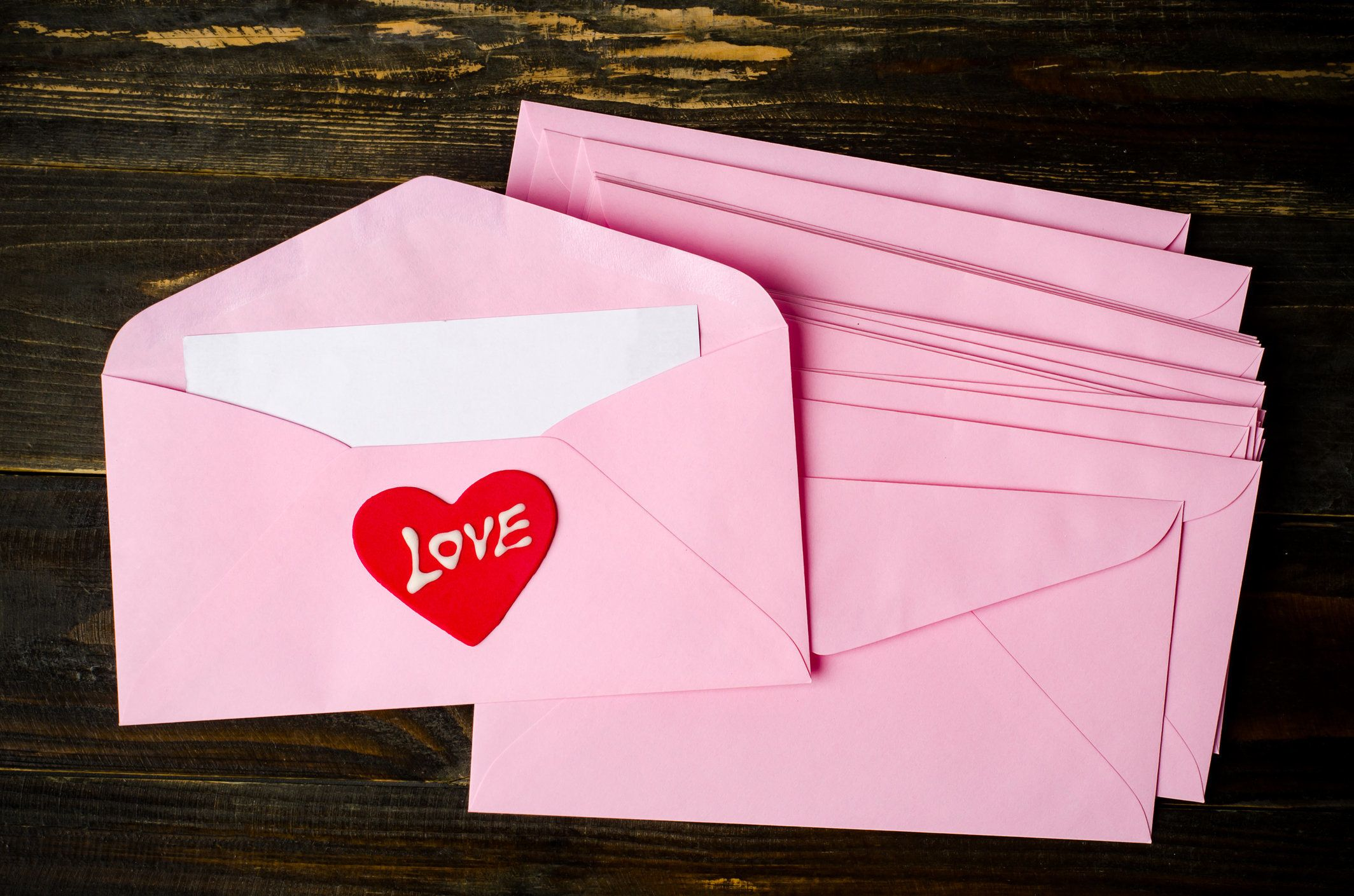 Pink envelope with blank white card and love heart