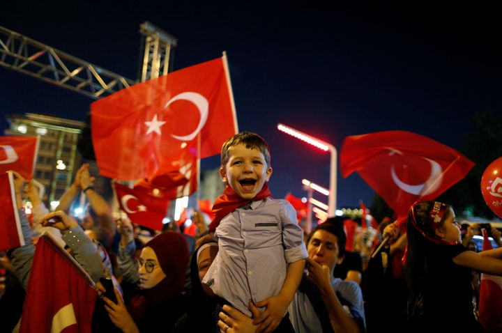 Supporters of Turkish President Tayyip Erdogan attend a pro-government demonstration at Taksim square in Istanbul on July 17,